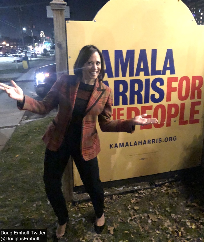 This image has an empty alt attribute; its file name is Kamala-Oct-31-2019-Orange-Plaid-Valentino-Blazer-Standing-Outside-Headquarters-Sign-in-Iowa-DE-Tw.jpg