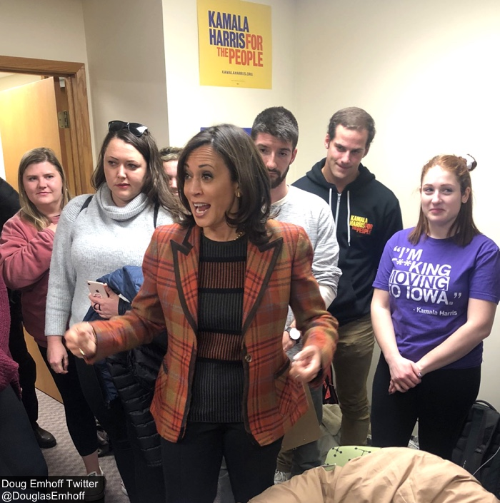 This image has an empty alt attribute; its file name is Kamala-Oct-31-2019-Orange-Plaid-Valentino-Blazer-Standing-in-Cmapaign-Headquarters-with-Volunteers-via-Doug-Tw.jpg